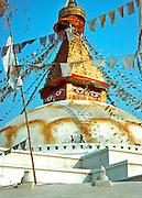 NEPAL, KATHMANDU Buddhist temple or stupa with traditional prayer flags at Bodnath near Kathmandu