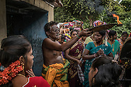 Priest at Iyyanarappan Temple performes a ritual as part of the Ganesh Chaturthi Festival. Chinna Mudaliyar Chavady, Tamil Nadu, India.