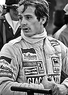 A relaxed Gilles Villeneuve prepares to win the 1979 US Grand Prix. He always said his job with Ferrari was to be the fastest in every practice session, in every qualifying session, through every corner, on every lap, through every lap of a race, and if he was, he would win. World championship titles meant nothing to him if he had to hold back. He was a Formula One driver and that meant being at 100-percent. <br /> <br /> His victory would ensure his second place ranking in the 1979 World Driving Championship, give Ferrari both first and second in the Driver's Championship, and guarantee Scuderia Ferrari the Constructor's Championship with the 312 T4.<br /> <br /> He always had the air about him that he could do things that no one else could; that he could find someway to carry a bad handling car around on his shoulders. The press felt it, reveled in it and built his legend one lap at a time. His fans, seeing him climb from a smoldering, wrecked Ferrari, felt he had left nothing on the table&hellip;and that Ferrari should just gather themselves and build him a faster car.