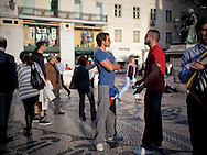 Local people at  Largo do Chiado, next to the famous A Brasileira coffe shop.This photograph is part of a body of work about Lisbon, feelings, affections and loneliness. Is about a city depressed by the crisis, but even so, tolerant and cosmopolitan. This part of Lisbon, the old town, with his deep character, where local people meets foreigners and alternative ways of life mixes with shamefaced poverty, is sublime by its peculiar light.
