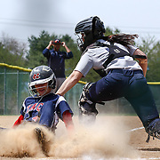 Goldey-Beacom Catcher Alivia Schoff (7) attempts to tag Nyack outfielder Anna Bailey (4) at home plate during a NCAA Central Atlantic Collegiate Conference game between Nyack College and Goldey-Beacom Saturday, April 19, 2014, at Nancy Churchmann Sawin Athletic Field in Wilmington Delaware.<br /> <br /> Goldey-Beacom defeats Nyack College 10-5 in Game 1<br /> <br /> Nyack College defeats Goldey-Beacom 1-0 in Game #2