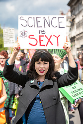 © Licensed to London News Pictures. 22/04/2017. London, UK. A woman holds a 'Science is Sexy' placard as thousands of scientists and science enthusiasts take part in the March for Science to raise awareness of the importance of scientific discovery and integrity. Photo credit: Rob Pinney/LNP