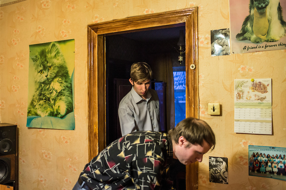 LUHANSK, UKRAINE - MARCH 15, 2015: Pavel Pavlov, left, and Aleksandr Kryukov at the house were Kryukov lives with his grandmother in Luhansk, Ukraine. CREDIT: Brendan Hoffman for The New York Times