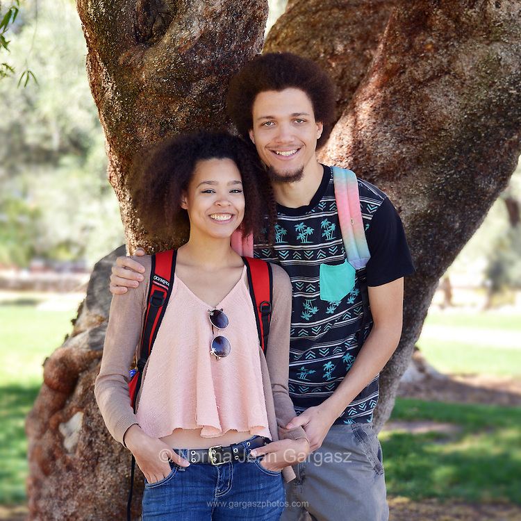 A young woman and man on a college campus.