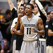 SHOT 2/26/11 4:34:53 PM - Colorado's Cory Higgins (#11) and teammates celebrate in the closing moments of their upset of Texas during their regular season Big 12 basketball game at the Coors Events Center in Boulder, Co. Colorado upset the fifth ranked Texas 91-89. (Photo by Marc Piscotty / © 2011)