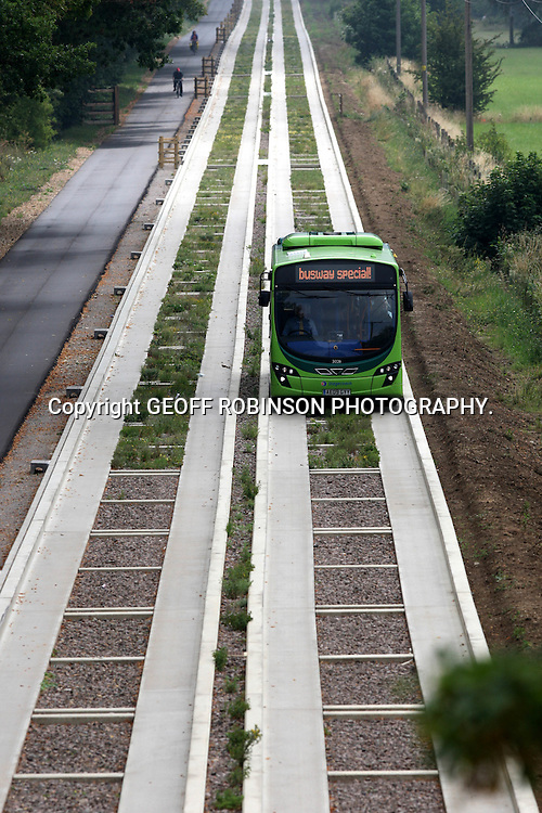 PIC SHOWS THE FINAL TESTS ON THE WORLDS LONGEST GUIDED BUSWAY IN CAMBRIDGE HELD ON THURSDAY JULY 28TH BEFORE THE OPENING NEXT WEEK... Final tests have been carried out on the LONGEST guided busway in the world in the historic city of Cambridge today (Thurs) ahead of its opening next week...The first commercial passengers will be able to board the eco-friendly buses next Sunday (Aug) 7 after the £116 million scheme was finally completed - two-and-a-half years late...The 26 kilometre track, which is more than TWICE the length of the current longest guided busway in Adelaide, Australia, was due to open in Spring 2009...But ongoing rows between Cambridgeshire County Council and contractors BAM Nuttall means the project has been severely delayed and gone several million over budget...The scheme was first proposed in 2001 to take pressure away from traffic on the notoriously congested A14 dual carriageway around Cambridge and offer a more reliable form of public transport...It allows plush air-conditioned buses, complete with wi-fi, to travel at up to 60mph along a disused rail line, using guide wheels running along concrete channels. ..SEE COPY CATCHLINE Longest guided busway in world opens..