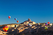 Hot Air balloons with Church Rock in background; Red Rock Balloon Rally at Red Rock State Park, Gallup, New Mexico.