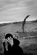 BAM, Iran - Mourning the loss of relatives.
