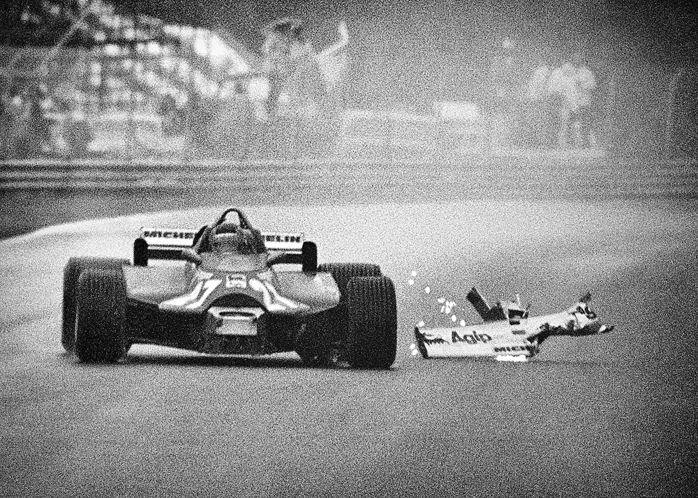 After completing two laps driving nearly blind in the rain, Gilles Villeneuve&rsquo;s Ferrari finally sheds it&rsquo;s broken nose wing as Villeneuve splashes to a heroic third place at the 1981 Canadian Grand Prix in Montreal. <br /> <br /> Villeneuve had damaged the wing and it had proceeded to flip up, obstructing his view. While the French Canadian&rsquo;s fans feared he would be black-flagged, Villeneuve pounded on in the dreadful conditions, without hesitation. It finally fell from the car as he braked hard, leaving him free, and without front downforce to slither on the finish.<br /> <br /> He said his job with Ferrari was to be the fastest in every practice session, in every qualifying session, through every corner, on every lap, through every lap of a race, and if he were, he would win. World championship titles meant nothing to him if he had to hold back. <br /> <br /> He was a Formula One driver and that meant being at 100-percent. <br /> <br /> He always had the air about him that he could do things that no one else could; that he could find someway to carry a bad handling car around on his shoulders. <br /> <br /> The press and fans felt it, reveled in it and built his legend one lap at a time