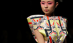 A model presents a creation from the Minzu University of China Collection during the Mercedes-Benz China Fashion Week in Beijing, China, 27 March 2013. The Mercedes-Benz China Fashion Week will run from 25 to 30 March.