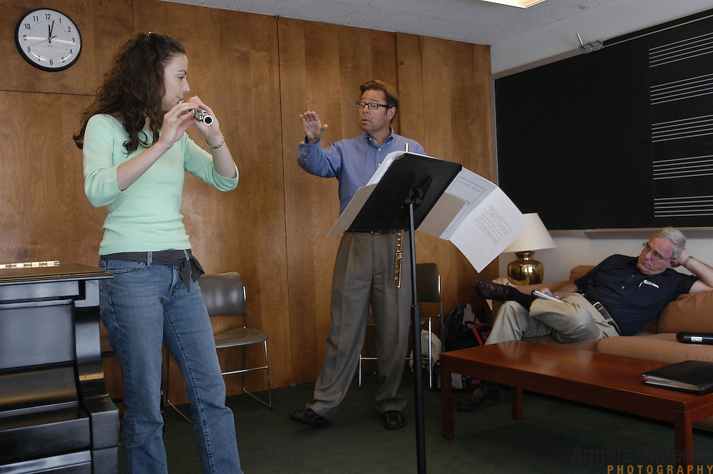 Megan Emigh, 17, left, of Haddonfield, New Jersey, takes her weekly private flute lesson with Dr. Bradley Garner, center, in the Pre-College Division program at The Juilliard School, located at West 65th Street and Broadway in New York City, on Saturday, September 24, 2005. Emigh's father, right, David Emigh, sits in on the lesson and takes notes. Students audition for spots in the prestigious program, in which they can study until they graduate from high school.