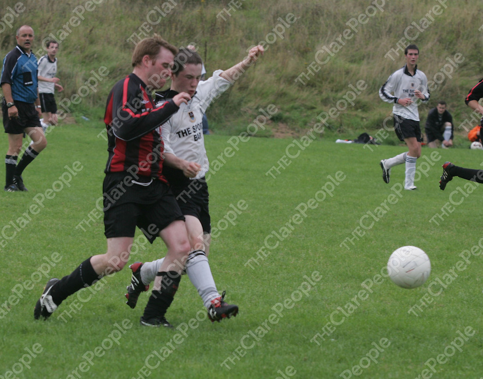 Bunratty's Damion Landy and Rinnanna Rovers Andy Downes battle for the Ball during their Game played in Bunratty.<br />