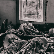 Sarajevo - 23 July 2013 - Seherzada and  her children sleeping in the same bed.