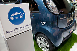 Electric Peugeot car at recharging station on display at Frankfurt Motor Show 2009