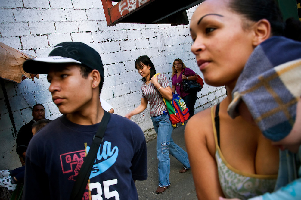 "(left) Diana Blanco Pina, 24, lives on the 7th floor of the ""Tower of David"" with her four children.  Squatters live in the bottom 28 floors of the 45-story uncompleted skyscraper, located in downtown Caracas, Venezuela. More than 2,500 squatters now occupy the building. Richard Neuwirth, the New York-based author of ""Shadow Cities,"" a book about living in squatter settlements in four continents, said that to his knowledge the Tower of David was the world's highest squatted building."