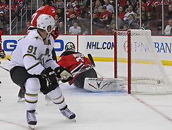 Oct 8; Newark, NJ, USA; Dallas Stars center Brad Richards (91) scores a goal past New Jersey Devils goaltender Martin Brodeur (30) during the second period at the Prudential Center.