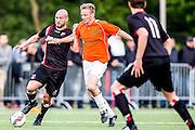 DEN HAAG - HBS - MSC , Sportpark Craeyenhout , Voetbal , Promotie/degradatie topklasse , seizoen 2014/2105 , 28-05-2015 , HBS speler Dominique Broekhuizen (l) in duel met MSC Jeroen Kleene (r)