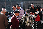 Locals congregate in the large square in Casco Viejo (old town) of Bilbao on a Sunday morning to exchange football cards.