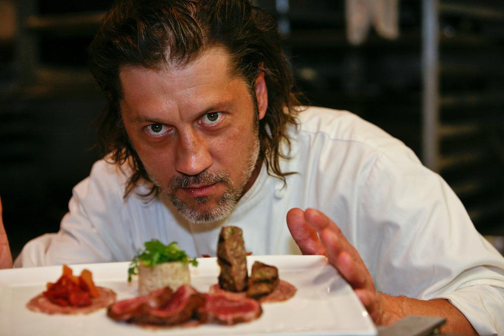 Chef Jamie Stachowski displays a charcuterie plate at Restaurant Kolumbia.
