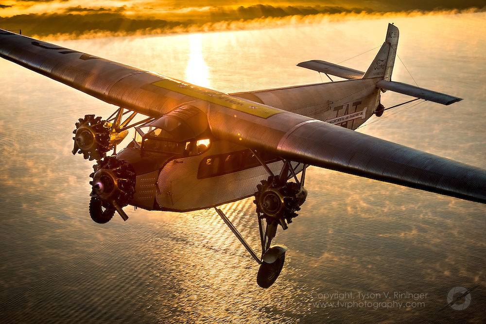 """This 1929 Ford 4-AT-E Tri-Motor, registered NC9612, has a unique and storied history. In 1929, it was delivered as a new passenger plane to Mamer Flying Service in Spokane, Washington. It was later sold to K-T Flying Service of Honolulu and was at Pearl Harbor on December 7, 1941, where it suffered superficial bullet holes from Japanese strafing. Brought back to the mainland in 1946, it was leased by TWA for their 1949 20th Anniversary celebration. It then went to an agricultural operator in Idaho and was modified to a sprayer and also as one of the pioneer forest fire fighting air tankers. Johnson Flying Service in Montana flew it for several years to drop Smoke Jumpers and supplies to fire fighters. Since 1969, the plane has been privately owned, hangared and was part of the Wings and Wheels museum collection previously located in Orlando, FL. This was a no concession, no compromise restoration in which the airframe was reworked, a new interior installed and the exterior completely re-skinned, with most work being performed under the supervision of Master Restorer Bob Woods of Woods Aviation in Goldsboro, NC. The wings were reworked and re-skinned by expert craftsman Maurice Hovious of Hov-Aire in Vicksburg, Michigan. The landing gear, including the unique Johnson bar braking system, is complete and original. The original straight-laced wire wheels have tires that were re-sculpted to replicate the correct profile and tread pattern of the period. The wood paneling of the interior has been skillfully re-created. There are no modern avionics or communications gear - just what came with the plane when it was delivered from the Ford factory in January of 1929. Exhaustive efforts were made to ensure originality in every detail with assistance from Tim O'Callaghan of the Henry Ford Museum and American Aircraft Historian Bill Larkins, author of """"The Ford Tri-Motor"""" book. Also assisting were Retired Eastern Airlines Captain Bob Beitel and Retired Admiral Witte Freeman of t"""