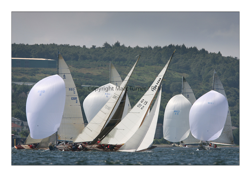 Sailing -Day 2 racing at the 8 metre World Championship 2007 held on the Clyde at The Royal Northern & Clyde YC as part of it's Centennial year...The 8 Metre Fleet with GBR 2 Lafayette and Anne Sophie G15 Upwind...