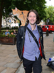 James Bowen and Street Cat Bob arrive at signing of their new book at Waterstones, Islington, London on Saturday 19th July 2014