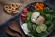Italian tuna and spinach salad with all kinds of healthy ingredients like ricotta salata cheese, egg, sundried tomatoes, olives and sweet potatoes. A few Taralli crackers on the side.