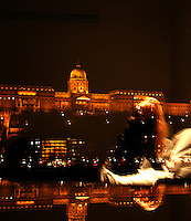 At the banks of Donau, from the Pest side with views of the Buda Castle which is located on the Buda side - Ved Donaus bredder, fra Pest-siden med utsikt mot Buda-slottet som ligger på Buda-siden....Mirror image of a lady who sits in the hotel roome bed and looking at Buda Castle on the Danube bank in Budapest....Speilbilde av dame som sitter i en hotellseng og ser mot Buda-slottet ved Donaus bredd i Budapest..........