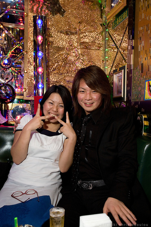 """Hana (25) office employee, is a regular customer in club """"Ai"""" going there 1-2 times a week, and her favorite host is Genki, because she likes his personality and he makes her have a good time. She usually spends about 20000 in each visit to the club.. Club """"Ai"""" (love in Japanese) is one of the oldest host clubs in Kabukicho entertainment area near Shinjuku. It started functioning 37 years ago, with hosts ready to take care of the needs of their female customers. The customers have to pay from 5000 friendly price for beginners, to millions of yen, depending on how good the host is in pleasing the customer and encouraging her to buy drinks. On top of these a good host can receive expensive gifts from his regular customers.  Tokyo - JAPAN"""