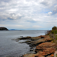 Brief History of Bar Harbor, Maine<br /> Native Americans lived along the coast of present-day Maine for thousands of years before Samuel de Champlain, a French explorer, came ashore in 1604. He called his discovery &ldquo;Isles des Monts Deserts.&rdquo; The main island&rsquo;s English name remains Mount Desert and the surrounding waterway is Frenchman Bay. Look again at this photo. From this peaceful shoreline you can see nine wooded islets. Surely this view is why the first European settlers called their town Eden. But when it was incorporated in 1796, the namesake was actually Sir Richard Eden, an English statesman. By the time it was renamed Bar Harbor in 1918, the town had become a resort community and summer residence for the wealthy and famous. Tragically, many of their mansions were destroyed by a fire in 1947. The ten-day blaze devastated most of the island.