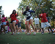 Students dance at an Ole Miss pep rally in the Grove in Oxford, Miss. on Thursday, September 1, 2011.