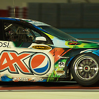 greg murphy (pespi max crew) during YAS V8 400  in yas marina circuit, abu dhabi UAE.11 february 2011.winners Jamie Whincup - team vodaphone (1), Alex davidson - irwin racing (2), makr winterbottom - orrcon steel fpr falcon (3)...real action heroes event..Providing the action for the main event are the Australian V8 Supercars, a two-car series of makers Holden and Ford - a close rivalry that runs deep in Australian culture. This season, that rivalry is heightened by the switch of 2010 series Champion James Courtney, who drives with the coveted No.1 plate, from his winning 2010 Ford Falcon to the Holden Commodore for 2011.
