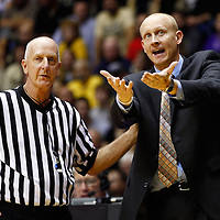 WEST LAFAYETTE, IN - DECEMBER 01: Head coach Chris Mack of the Xavier Musketeers protests a call against the Purdue Boilermakers at Mackey Arena on December 1, 2012 in West Lafayette, Indiana. Xavier defeated Purdue 63-57. (Photo by Michael Hickey/Getty Images) *** Local Caption *** Chris Mack
