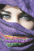 Model Released: Attractive young  woman with clear blue eyes with her face covered