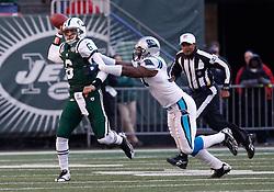 Nov 29, 2009; East Rutherford, NJ, USA; New York Jets quarterback Mark Sanchez (6) runs away from a Carolina Panther defender during the first half at Giants Stadium. Mandatory Credit: Ed Mulholland-US PRESSWIRE