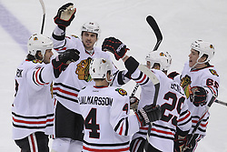 Mar 27; Newark, NJ, USA; The Chicago Blackhawks celebrate a goal by Chicago Blackhawks defenseman Brent Seabrook (7) during the third period at the Prudential Center. The Devils defeated the Blackhawks 2-1 in an overtime shootout.
