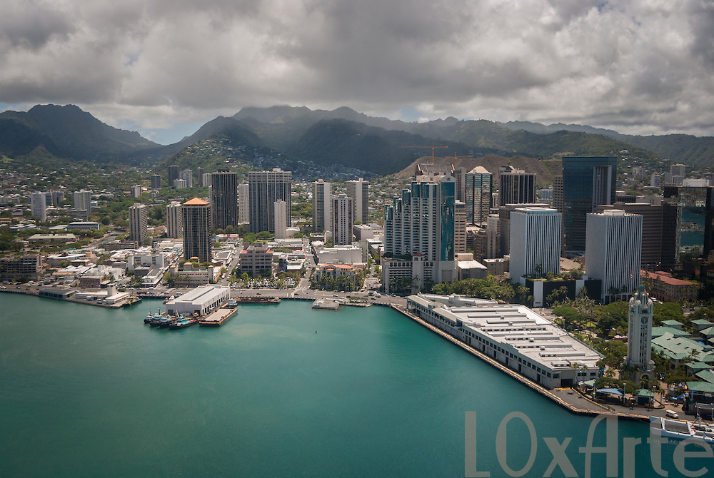 Aerial view of Honolulu Harbor, Hawaii with looming clouds above the hills. The image is available for commercial licensing through Arcangel Images. ID# AA1644962 . Contact LOxArte for Fine Art Prints.