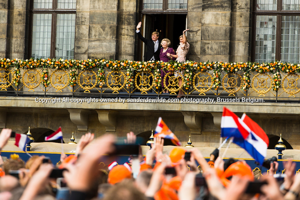 30th April 2013 Amsterdam, Netherlands. Dam Square. Queen Beatrix' abdication takes place, and her son Prince Willem-Alexander will be King of the Netherlands. from left to right King Willem Alexander holding his mother princess Beatrix and queen maxima wave at the thousands enthousiast Dutch from the balcony