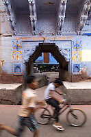 """Indian kids playing on the streets of Jodhpur which is often called the """"blue city"""". Today Jodhpur is a popular tourist destination set near the barren landscape of the Thar desert.  Jodhpur is called the """"Blue City"""" thanks to the vivid blue painted houses under the Mehrangarh Fort."""