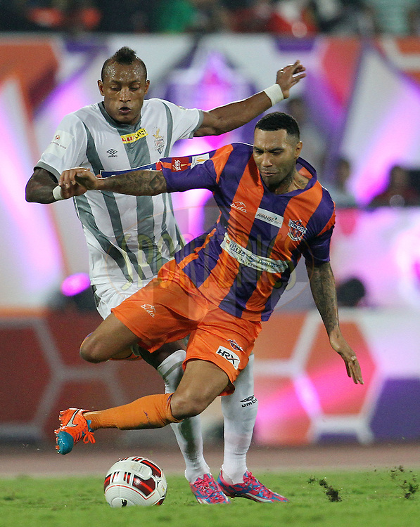 Fikru Tefera Lemessa of Atletico de Kolkata and Jermaine Pennant of FC Pune City in action during match 44 of the Hero Indian Super League between FC Pune City and Atletico de Kolkata FC held at the Shree Shiv Chhatrapati Sports Complex Stadium, Pune, India on the 29th November 2014.<br /> <br /> Photo by:  Vipin Pawar/ ISL/ SPORTZPICS
