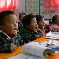APRIL 3,2012 : Tibetan children study at a privately run Tibetan kindergarden in Tongren county.