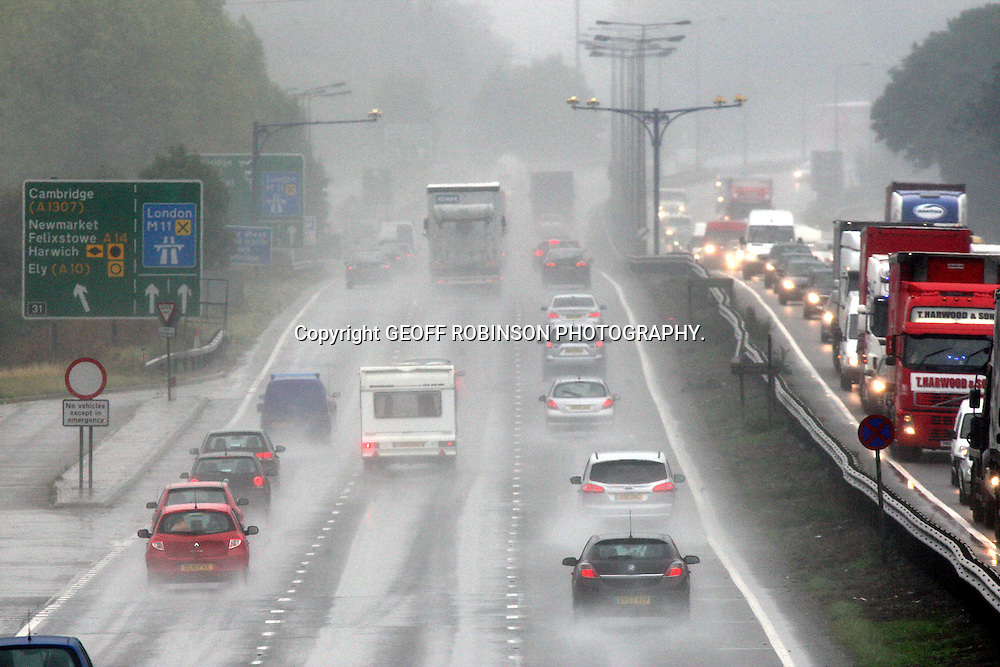 PIC BY GEOFF ROBINSON PHOTOGRAPHY 07976 880732...PIC SHOWS HEAVY RAIN AND DARK CONDITIONS ON FRIDAY LUNCHTIME ON THE A14 IN CAMBRIDGE WHICH RESULTED IN TRAFFIC JAMS AS PEOPLE  STARTED THEIR TRIPS AWAY OVER THE BANK HOLIDAY WEEKEND... Britons heading off for the bank holiday weekend can expect cool and showery weather..Aside from the elements, those motorists who made journeys early on Friday had to contend with a number of accidents and traffic jams on major routes..There was congestion on the A14 in East Anglia and an accident on a busy stretch of the M1 north of Luton in Bedfordshire led to delays. There were also accidents on the M6 and M11 as the first of an estimated 16 million vehicles took to the road..Drivers found that a number of roadworks on England's motorways and major trunk roads had been completed by the start of the getaway, with others being suspended over the holiday..But more than 20 sets of works remain in place and motoring organisations were expecting heavy traffic on routes to the coast and in areas where events are taking place, such as the Reading and Leeds music festivals..Channel Tunnel shuttle train company Eurotunnel said it planned to run a full service over the weekend even if a threatened strike by its French workers goes ahead as planned from Saturday.