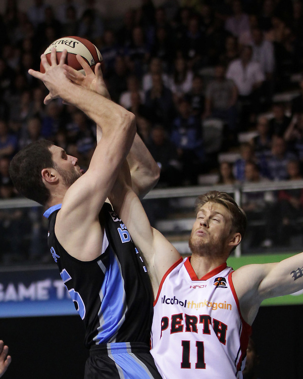 Breakers' Alex Pledger  in action against Wildcats' Cameron Tovey in round 1 of an ANBL Basketball Match, North Shore Events Centre, Auckland, New Zealand, Friday, October 05, 2012.  Credit:SNPA / David Rowland