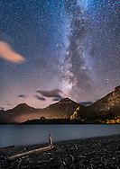 The Milky Way over the distant Prince of Wales Hotel from Driftwood Beach, in Waterton Lakes National Park, September 24, 2016. Being at the end of the season, the hotel is closed and dark. The bright star at centre is Altair in Aquila.<br /> <br /> This is a stack of 4 x 30 second exposures, mean combined, to smooth noise, and one 30 second exposure for the sky, all with the Sigma 20mm lens at f/2.5 and Nikon D750 at ISO 6400.