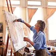 Even Sam Woolcott will admit she scored the best studio at Central School Project, a non-profit creative space for working artists. The corner room with its endless windows and high ceilings make even a non-artist want to pick up a brush and give painting a try. For Woolcott, a mixed media artist originally from the East Coast, the natural light and the cool afternoon breezes are the perfect recipe for working on her latest project — Bisbee homes sketched from below. This most recent project, brought Woolcott out of her studio and onto the streets...well actually, into the drainage ditches. Armed with a sketchbook, Woollcott can be found laying or sitting in the town ditches, looking up at pedestrian bridges, walkways and houses of Bisbee. An architecture student in her earlier life, Woolcott has found a way to bridge her love of lines and angles with her passion for paint, color and textures.