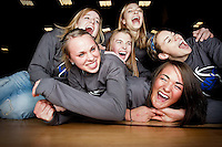 JEROME A. POLLOS/Press..Coeur d'Alene High varsity basketball seniors Sadie Simon, left foreground, and Kama Griffitts are dogpiled by teammates Kelsi DeHaas, left, Amy Warbrick, Whitney Heleker and Natalie Stewart. The six seniors will take on Idaho's best teams this week to earn their second state title in as many years.