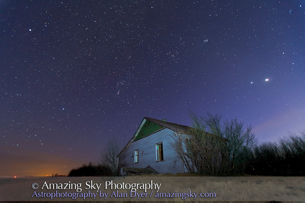 Orion, with Sirius, Procyon and Aldebaran, and Venus and Jupiter at right, over old farmstead buildings near home, March 10, 2012. Taken with Canon 5D MkII and 16-35mm lens 20mm and at f/2.8 for 30 seconds at ISO 1250. I used an LED flashlight to illuminate the old house and foreground.