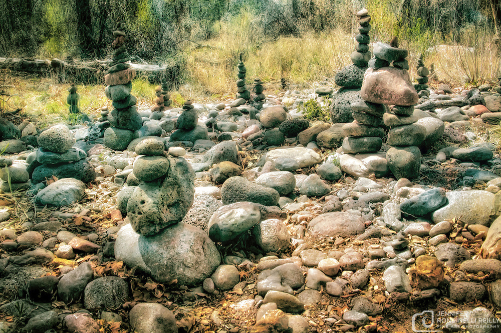 Photo of rock cairns that can be seen while exploring the trail to Buddha Beach at Crescent Moon Ranch in Sedona, AZ.
