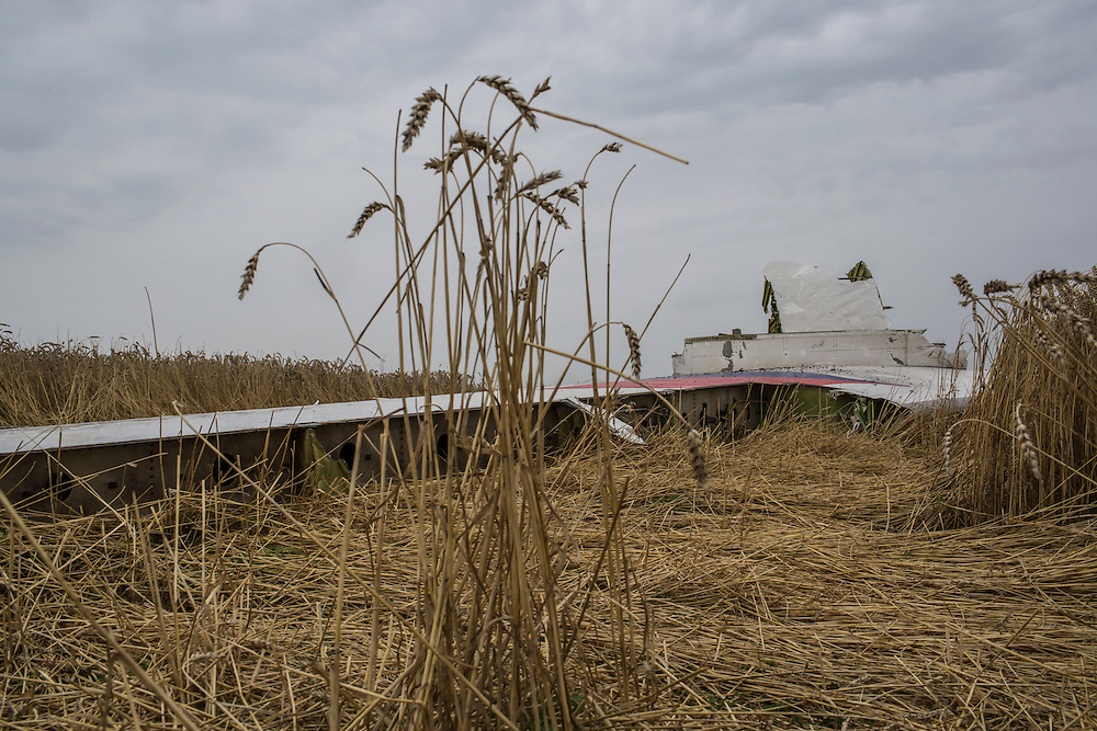 GRABOVO, UKRAINE - JULY 18: The tail from an Air Malaysia plane crash lies in a wheat field on July 18, 2014 in Grabovo, Ukraine. Malaysia Airlines flight MH17 travelling from Amsterdam to Kuala Lumpur has crashed on the Ukraine/Russia border near the town of Shaktersk. The Boeing 777 was carrying 280 passengers and 15 crew members. (Photo by Brendan Hoffman/Getty Images) *** Local Caption ***