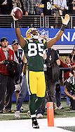 Green Bay Packers' Greg Jennings after scoring an 8-yard touchdown in the 4th quarter. .The Green Bay Packers played the Pittsburgh Steelers in Super Bowl XLV,  Sunday February 6, 2011 in Cowboys Stadium. Steve Apps-State Journal.